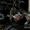 Flight Medic Looks After A Mock Patient by Terry Moore