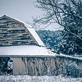 Fresh Snow Sits On The Ground Around An Old Barn by Alex Grichenko