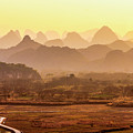 Karst Mountains Scenery In Sunset by Carl Ning