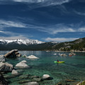 Lake Tahoe Scene With Puffy Clouds And Snow On Mountains by Dan Friend