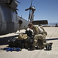 Pararescuemen Sorts Out His Gear by Terry Moore