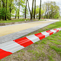 Red And White Barricade Tape by Alain De Maximy