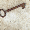 Rusty Key On Old Parchment by Michal Boubin