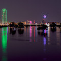 Skyline Of Dallas, Texas At Night Across Flooded Trinity River by Wendell Clendennen