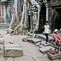Souvenir Trinket Stall Vendor In Angkor Wat Famous Temple Cambod by Jacek Malipan