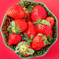 Strawberries In A Wooden Bowl On The Old Wooden Table by Tat Fung