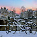 Sunset In Snowy Amsterdam In The Netherlands In Winter by Nisangha Ji
