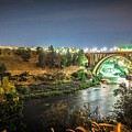 The Monroe Street Dam And Bridge At Night, In Spokane, Washingto by Alex Grichenko