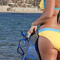 Woman Getting Ready To Go Snorkeling by Anthony Totah