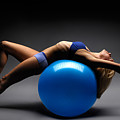 Woman On A Ball by Maxim Images Prints