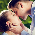 Young Romantic Couple Kissing With Love In Summer Park by Michal Bednarek
