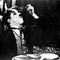 Chaplin: Gold Rush. 1925 by Granger