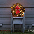 Christmas Wreath On Lawn Chairs by Jim Corwin