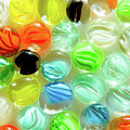 Colored Glass Beads On White Background by Alain De Maximy