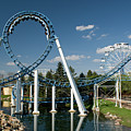 Cork-screw Rollercoaster And Ferris-wheel by Anthony Totah