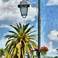 Lampost With Flowers In Nafplio Town by George Atsametakis