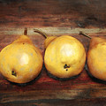 3 Pears On A Wooden Table by Julius Reque