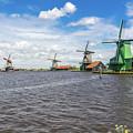 Traditional Dutch Windmills At Zaanse Schans, Amsterdam by Arnaud Martinez