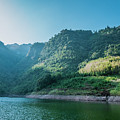 The Mountains And Reservoir Scenery With Blue Sky by Carl Ning