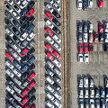 Aerial View Lot Of Vehicles On Parking For New Car. by Mariusz Prusaczyk