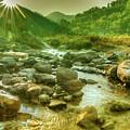 Nice River Water Flowing Through Rocks At Dawn by Rudra Narayan Mitra