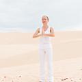 Young Woman Practicing Yoga by Nikita Buida