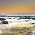 Hazy Dawn Seascape With Rocks by Merrillie Redden