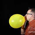 Man Inflating Balloon by Ted Kinsman