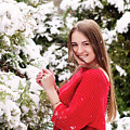 Beautiful Young Girl Model In Winter In A Parked Park. In A Red Sweater. by Oleksandr Masnyi