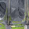 Mining Excavator On The Bottom Surface Mine.  by Mariusz Prusaczyk