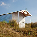 A Beach Hut In The Marram Grass At Old Hunstanton North Norfolk by John Edwards