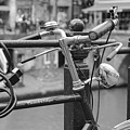A Bicycle Parked At Fence, Netherlands by David Ortega Baglietto