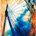 A Big Wheel Roller Coaster Ride Under A Sunset by Jeelan Clark