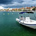 A Boat Floating In Rab, Croatia by Global Light Photography - Nicole Leffer
