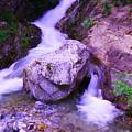 A Boulder Splitting The Rocks by Jeff Swan