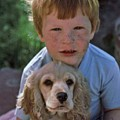 A Boy And His Dog With Evidence Of Stolen Brownie by Randy Sprout