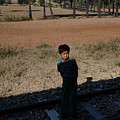 A Boy In Burma Looks Towards A Train From The Shadows by Jason Rosette