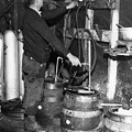 A Brewmeister Fills Kegs At A Bootleg by Everett