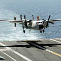 A C-2a Greyhound Prepares To Land by Stocktrek Images