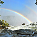 A Double Rainbow Over Victoria Falls by Don Mercer