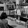 A Druggist Prepares Ice Cream Floats At A Soda Fountain by B Anthony Stewart