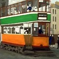 A Glasgow Tram With Figures And Tenement by Peter Gartner
