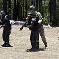 A Green Beret Instructs Tigres Trainees by Stocktrek Images
