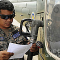 A Honduran Crew Chief Consults by Stocktrek Images