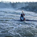 A Kayaker Takes On White Water Rapids by Kenneth Garrett