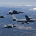 A Kc-135r Stratotanker Refuels Three by HIGH-G Productions