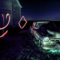 A Light Painted Scene Of A Rusty Caddy By A Barn And Cornfield by Sven Brogren