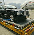 A Luxury Bentley Unloaded From An by Justin Guariglia
