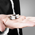 A Male Model Showcasing Cuff Links In His Hand by Jorgo Photography - Wall Art Gallery