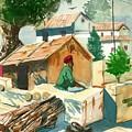 A Man Sitting Near A Tropical Village House by Makarand Joshi